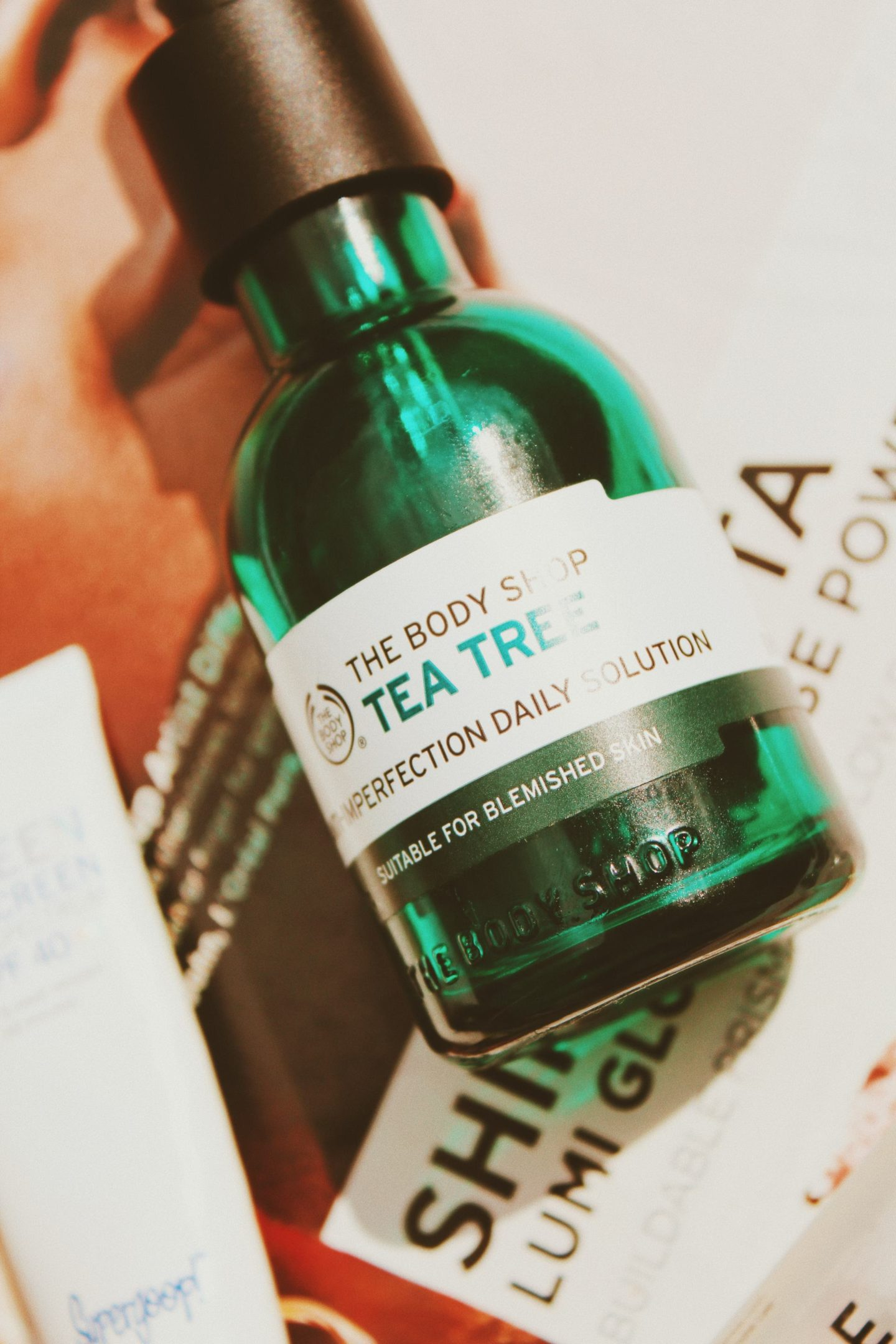 a close up shot of The Body Shop Tea Tree Anti-Imperfection Daily Solution,